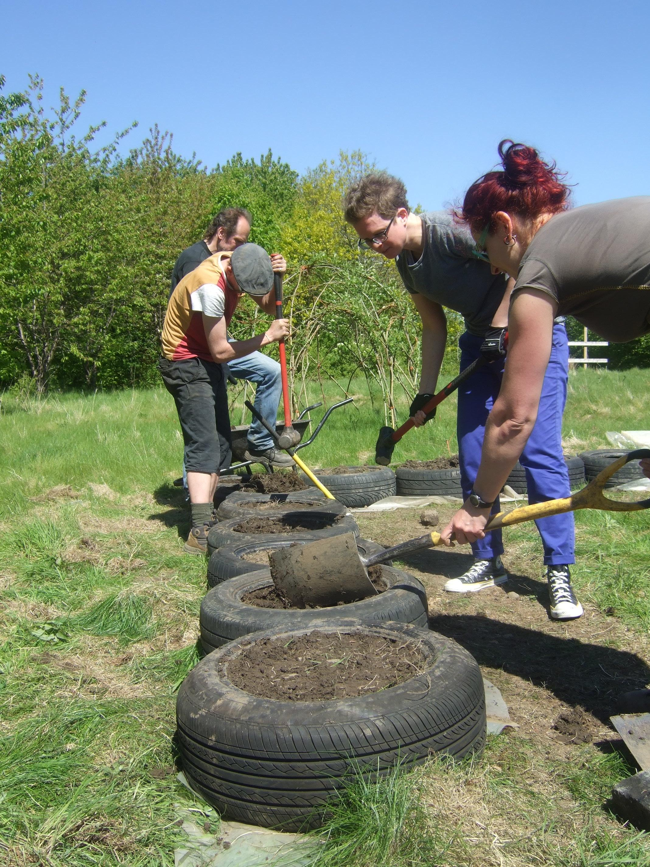 Building a tire wall at Urban Roots Permaculture project
